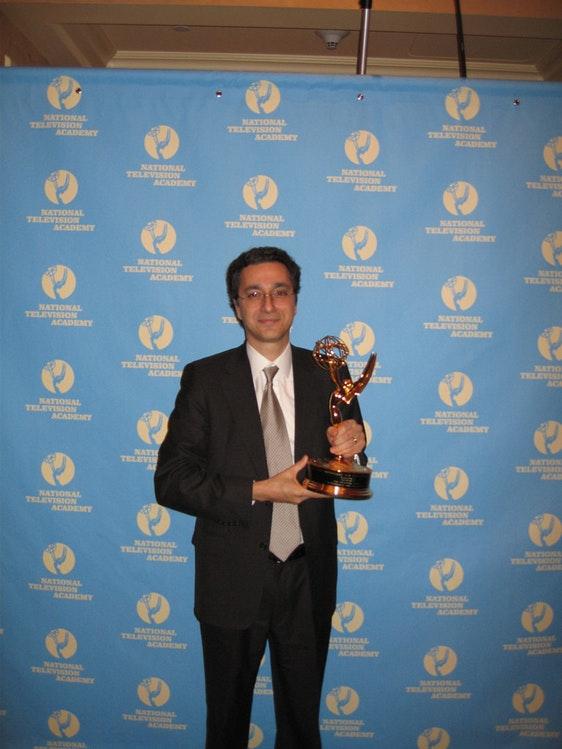 Amir with his Emmy Award.jpg