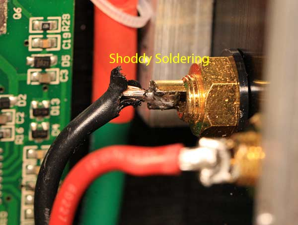 IRAUD350 Class D Amplifier IRS2092 Teardown shoddy soldering speaker terminal.jpg